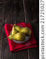 dewy fresh pears in a bowl 21725027