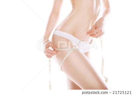 Slimming woman measuring thigh with tape 21725121