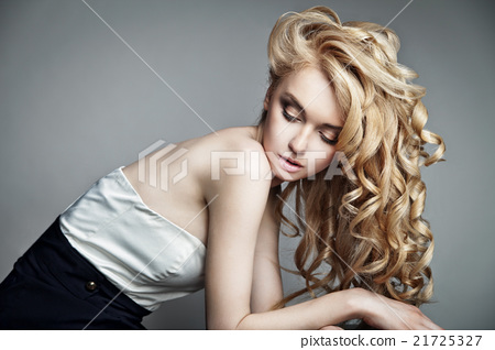 Sensual woman with shiny curly long blond hair 21725327