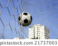 foot ball in the goal net 21737003