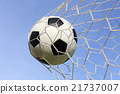 Soccer foot ball in goal net 21737007