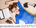 Young teenage girl lying on the floor with laptop 21737717