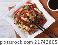 soba noodles with chicken and vegetables top view 21742805