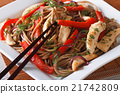 Yakisoba with chicken, vegetables on a plate macro 21742809