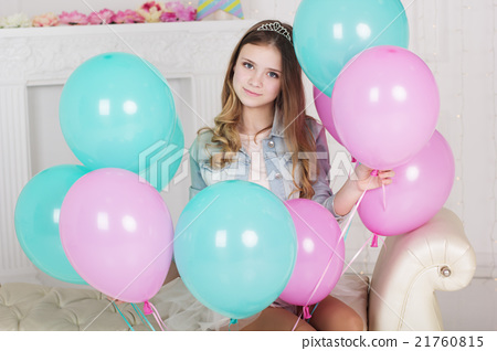 Pretty teen girl with many blue and pink balloons 21760815