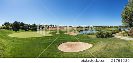 Panorama of a golf course sand trap and collar. 21761386