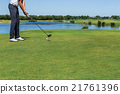 Male golfer hit the ball with stick. 21761396