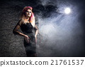Young woman in a Halloween outfit 21761537