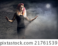 Young woman in a Halloween outfit 21761539