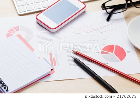 Office workplace with phone, charts and notepad 21762675