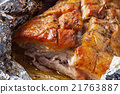 Tasty hot pork baked in foil  21763887