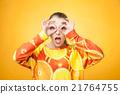 girl wearing orange printed sweatshirt  21764755