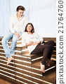 Couple at home sitting on stairs. Pregnancy 21764760