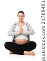 Pregnant woman relax doing yoga over white 21765451