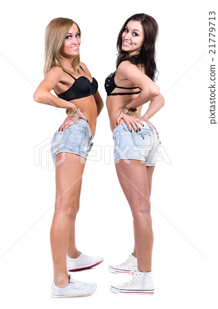 Full Length Portrait Of Two Sexy Young Women