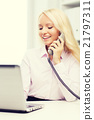 smiling businesswoman or student calling on phone 21797311
