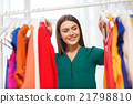 happy woman choosing clothes at home wardrobe 21798810