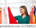 happy woman choosing clothes at home wardrobe 21798923
