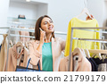woman calling on smartphone at clothing store 21799179