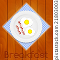White Plate with Fried Eggs on Kitchen Napkin at 21803003