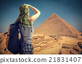 woman traveler with a backpack and the pyramids at Giza 21831407