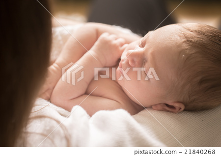 Newborn baby sleeping on sheet 21840268
