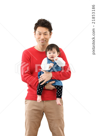 A young dad holding a baby 21853186