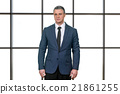 Worried mature businessman in suit. 21861255