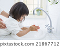 A 2 year old girl washing his hands 21867712