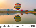 Hot air color balloon over lake with sunset time 21868994