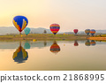 Hot air color balloon over lake with sunset time 21868995