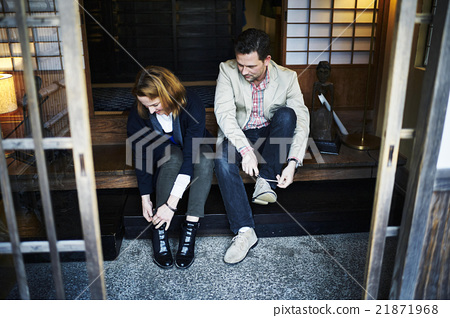 Foreigners wearing shoes at the entrance 21871968