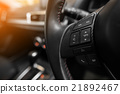Car Audio control buttons on the steering wheel 21892467