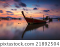 Long boat with beautiful sunrise view in the sea 21892504