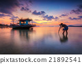 Long boat with beautiful sunrise view in the sea 21892541