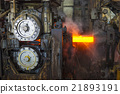 An incandescent bar made of steel in a steelworks  21893191