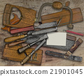 woodworking tools and business card over bench 21901045