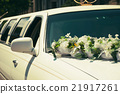 White wedding limousine decorated with flowers 21917261