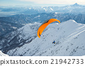 Paraglider launching from snowy slope 21942733