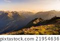 Warm light at sunset on mountain peaks, ridges and valleys 21954636