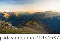 Warm light at sunrise on mountain peaks, ridges and valleys 21954637