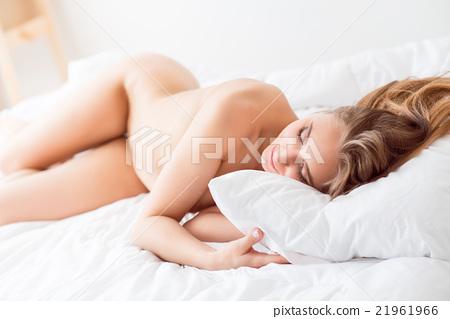 Naked girl lying in bed  21961966