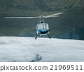 Single-engine helicopter landing on an ice field 21969511