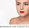 The beautiful woman face  with arrows close up 22022731