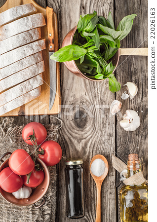 Ingredients for  bruschetta on the wooden table  22026163