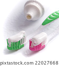 toothpaste and toothbrushes 22027668