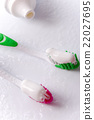 toothpaste and toothbrushes 22027695