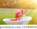 little girl bathes in a bath with soap bubbles 22088858