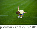 little funny boy on football field 22092305