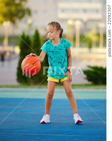 Stock Photo: photo of little cute girl playing basketball